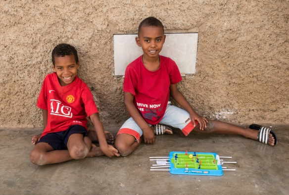 Two boys in a local neighborhood playing soccer, Mindelo, São Vicente, Cape Verde (Cabo Verde)