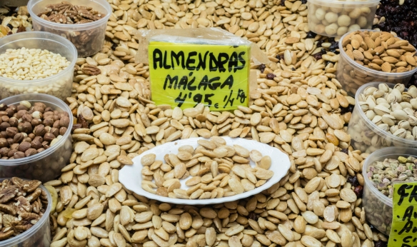 A local specialty is freshly fried and salted Marcona almonds, Mercado Atarazanas, Málaga, Spain