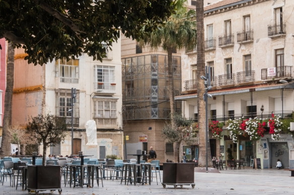A plaza in a residential section of Casco Antiguo (Old Quarter) with outdoor seating for a café, Cartagena, Spain
