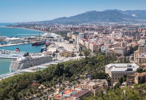 A view of Málaga, Spain, from the Castillo de Gibralfaro (Gibralfaro Castle) with the Puerto de Málaga (Port of Malaga) and our ship docked there on the left, the tree-lined Paseo de