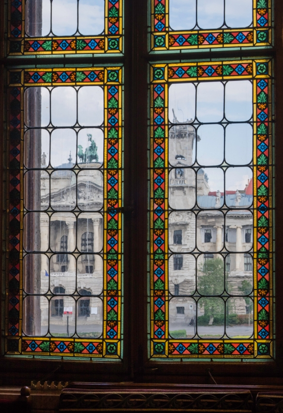 A view of the Hungarian Museum of Ethnography from windows with stained glass borders in the Hungarian National Parliament building, Budapest, Hungary