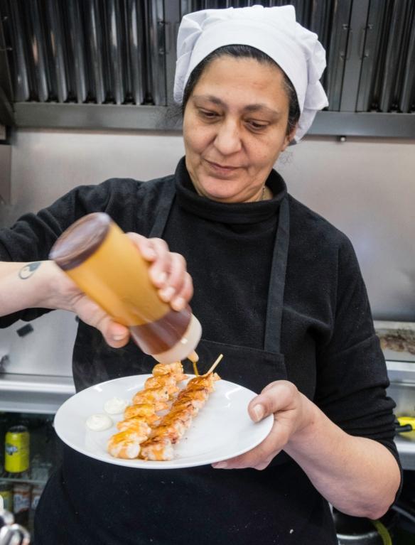 """Fast food"" for eating in the market – grilled local gambas (shrimp), Mercado Atarazanas, Málaga, Spain"