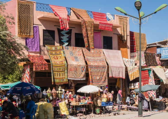 Moroccan carpets for sale, along with household goods, Marrakech, Morocco