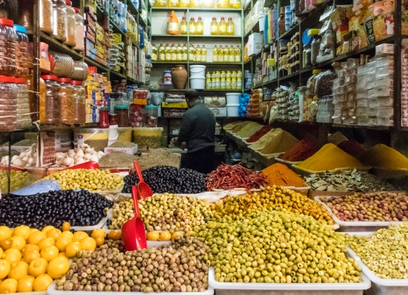 Olives, spices, oils and other goods for sale, Marrakech, Morocco