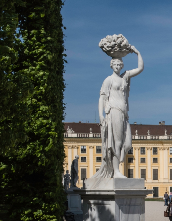 One of many sculptures in the garden of the imperial Schönbrunn Palace, the Hapsburgs_ summer palace within the city limits of Vienna, Austria, Vienna, Austria