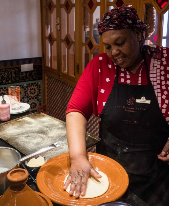 Our chef instructor, Ayada, deomonstrating the proper way to knead and shape the dough for traditional Moroccan flatbread, Cooking School, La Maison Arabe, Marrakech, Morocco
