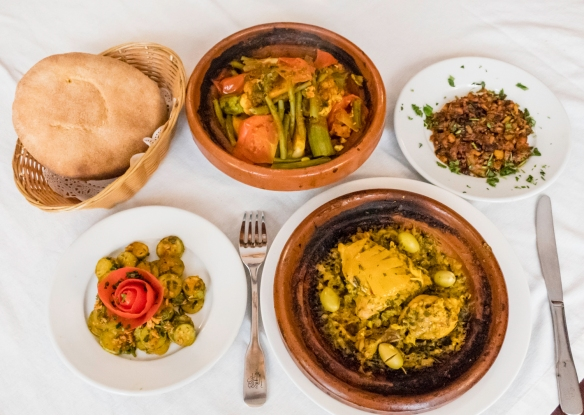 Our luncheon from our cooking class at La Maison Arabe included two tagines – vegetables and a chicken tagine with preserved lemon slices and green olives, traditional Moroccan flatbre
