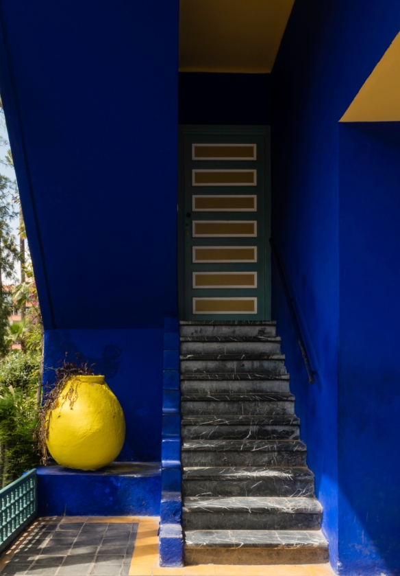 "Stairs, geometric patterns and the bold ""Majorelle blue"" outside the artist Jacques Majorelle_s studio (now a Berber Museum); Jardin Majorelle (Majorelle Garden), Marrakech, Morocco"