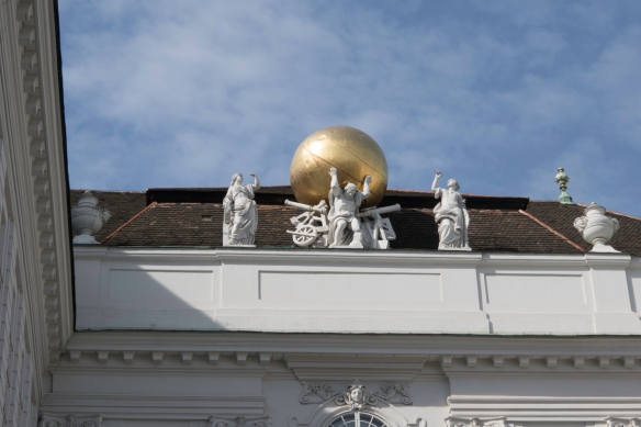 Statues on the roof of the National Library that is part of the Hofburg Imperial Palace on Josefsplatz, Vienna, Austria