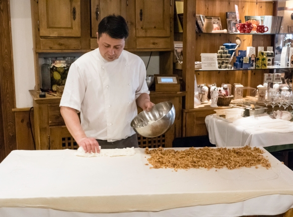The chef demonstrated kneading and stretching the strudel dough to a thinness that allowed us to read a menu through the dough – then he placed the fillings on the raw dough