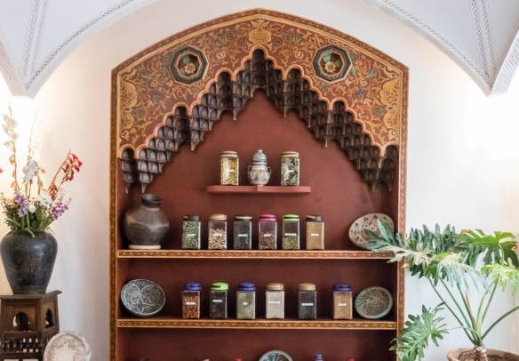 The dining room for the cooking school had bookcases full of spices and books on Morocco and Marrakech; at the luncheon from our cooking class at La Maison Arabe. Marrakech, Morocco