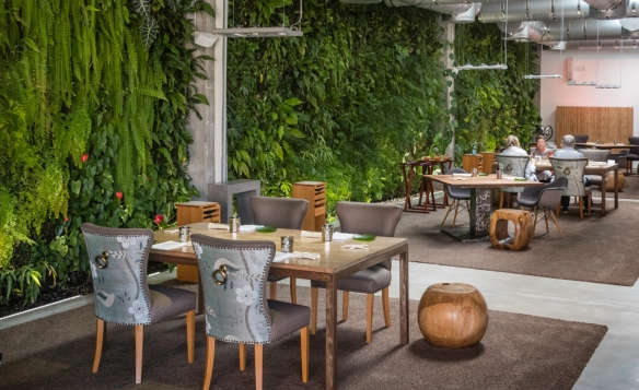 The indoor dining room at José Carlos Garcia Restaurante, Málaga, Spain, with its indoor vertical living garden wall; the intrepid explorer is at our table with our friends