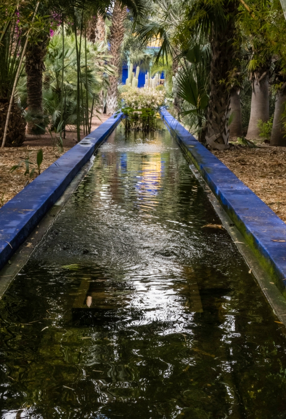 "The long waterway leading to the square fountain (painted in ""Majorelle blue); Jardin Majorelle (Majorelle Garden), Marrakech, Morocco"
