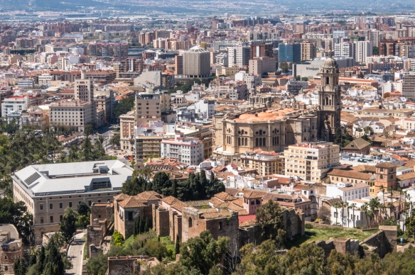 The Moorish Alcazaba Fortress (dating back to 1057) in the foreground and Old Town behind it, with the Málaga Cathedral in the center, Málaga, Spain