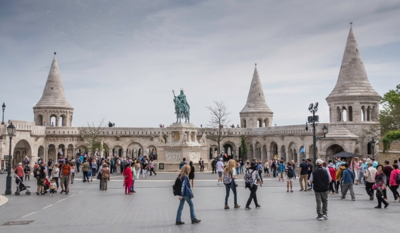 The mounted statue between Fisherman_s Bastion with its lookout terrace and the Matthias Church (Mátyás templom) is King Stephan (Istvan in Hungarian), the first king of Hungary (c