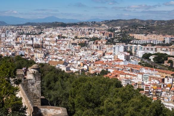 The northern residential neighborhoods of Málaga, Spain, as seen from Castillo de Gibralfaro (Gibralfaro Castle), partially pictured in the left foreground