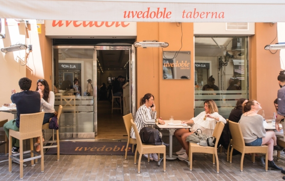 The outdoor seating area at the entrance of the modern tapas restaurant, uvedoble taberna, Málaga, Spain