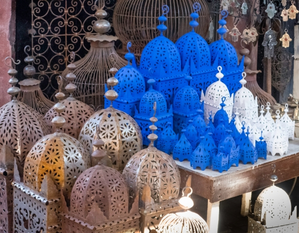 "Traditional Moroccan metal lamps (when hung with candles inside, ""stars"" are projected on the ceiling and walls of a darkened room) for sale in a souk, Marrakech, Morocco"