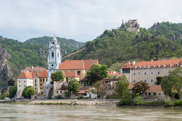 We sailed on a river boat along the Danube River in the Wachau wine-growing region, Austria; this small town along the river has a beautiful church built under towering medieval ruins