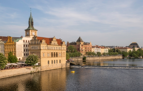 An early evening view of the central east bank of the Vltava River in Prague, Czech Republic, from the pedestrian Charles Bridge