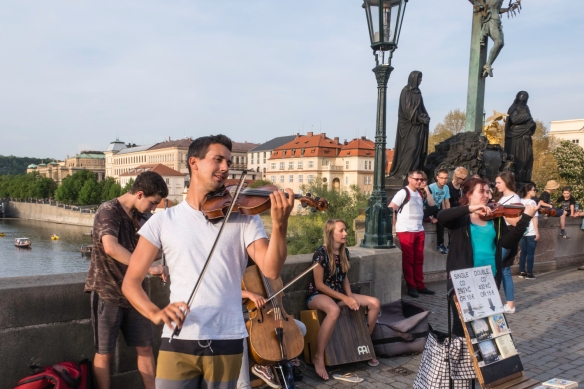 Musicians playing for the walkers on the pedestrian Charles Bridge in the early evening, Prague, Czech Republic