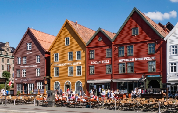 A close up of several of the brightly painted Bryggen gabled, wooden warehouses, Bergen, Norway