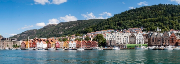 A panorama of of Bryggen (the dock) -- a series of Hanseatic commercial buildings lining the eastern side of the Vågen Harbor in Bergen, Norway -- since 1979 on the UNESCO list for Wor