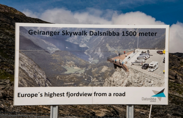 A road sign on the Trollstigen mountain road that leads up from sea level at Geiranger, Norway, to the 1,500 meters (nearly 4,900 foot) elevation at the Dalsnibba utsiktspunkt (Dalsnibba