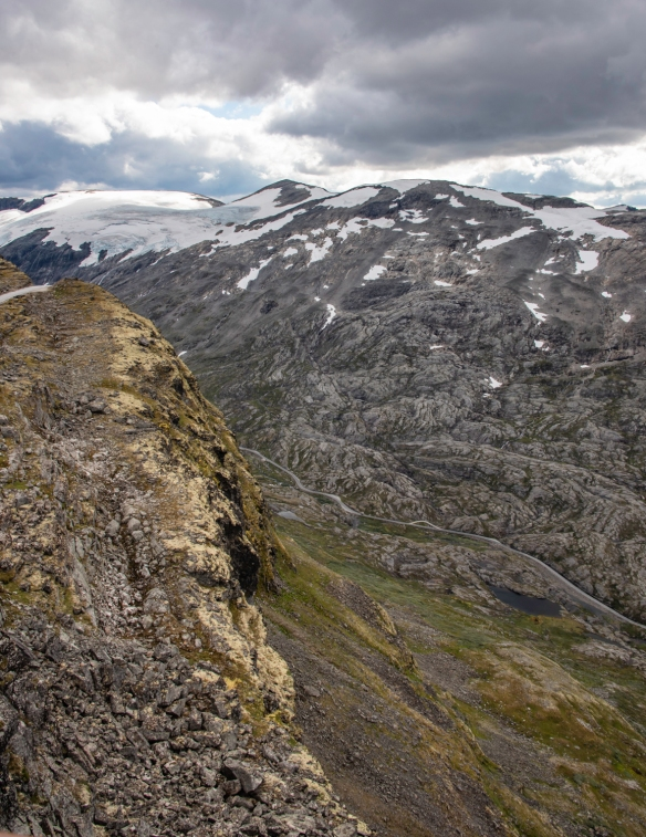 "A small vertical slice of the rugged mountain terrain visible from the viewpoint (""Skywalk"") at the top of Dalsnibba Mountain, Geirangerfjord, Norway"