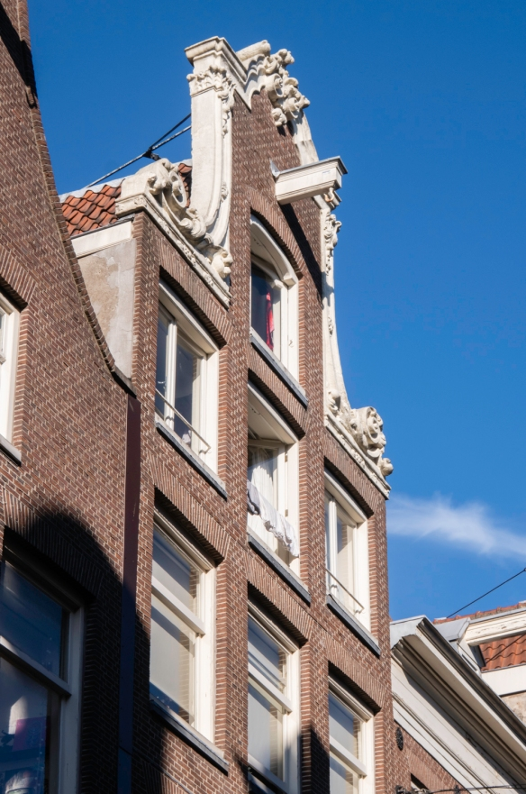 Along the canals in Amsterdam, The Netherlands, many old narrow former homes have beams cantilevered out over the street – in former times there was a pulley mechanism and ropes to hoi
