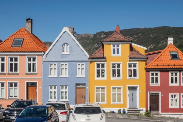 Beautiful painted homes from the 19th century in the Nordnes neighborhood atop the peninsula on the west side of the inner harbor (Vågen Harbor) of Bergen, Norway