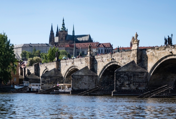 Behind the Charles Bridge, on top of the hill is Saint Vitus Cathedral – the largest and most important temple in the city -- located within Prague Castle (Czech- Pražsky hrad) – v
