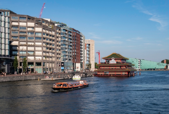 By contrast, replacing many old waterfront buildings are these modern structures with the Sea Palace Chinese Restaurant in the Oosterdok channel and the striking NEMO Science Museum rese