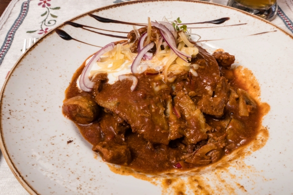 For our other main dish we had a local specialty, Placki po Cyygańsku (Gypsy style potato pancakes – on the bottom, not visible – with beef goulash and sour cream and onions); Rest