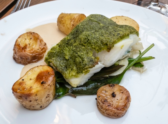 "Fresh local cod with a vegetable ""crust"" served on greens, with potatoes, Hemelse Modder, Amsterdam, The Netherlands"