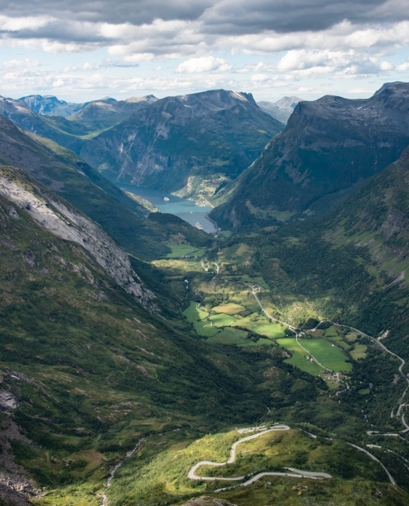 "Geirangerfjord and the twisting, winding Trollstigen mountain road viewed from the viewpoint (""Skywalk"") at the top of Dalsnibba Mountain, Geirangerfjord, Norway [""portrait"" (ver"