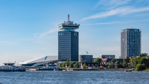 In the center, fronting on the Amstel River, is the A_DAM Lookout that opened in 2016, built on top of the building originally used by the Shell Oil Company, Amsterdam, The Netherlands