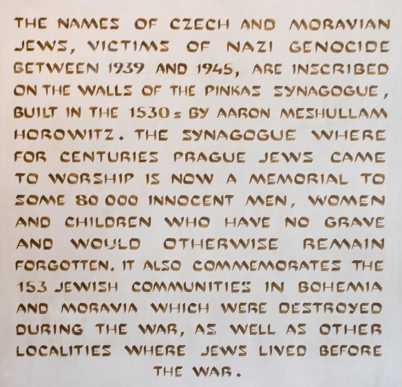 Introductory wall text at the Pinkas Synagogue, Prague, Czech Republic, explaining the 80,000 hand-written names on the restored walls of the Synagogue which now is part of the Jewish Mu