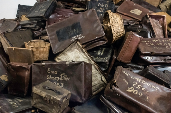 """Luggage (emptied of personal effects that were sorted and """"recycled"""" by the Nazis) from arriving detainees, Auschwitz, Oświęcim, Poland"""