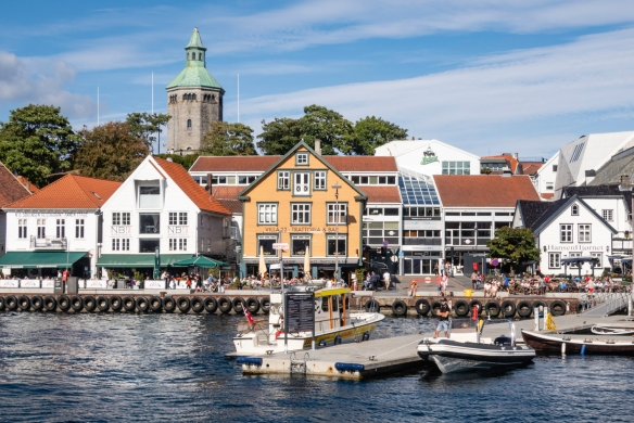 Restaurants and retail stores now occupy the ground floor of the older buildings along the east side of the harbor in Stavanger, Norway