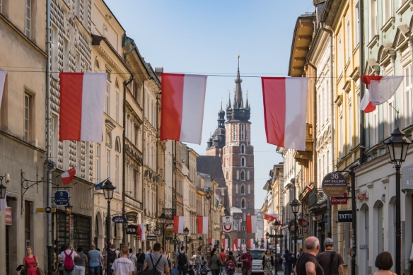 Shopping off the Main Market Square with the church spires of St. Mary_s Basilica in the background, Kraków, Poland