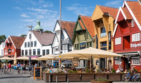 Shops in the Øvre Holmegate (Upper Holmegate) district that are painted in bright colors, Stavanger, Norway