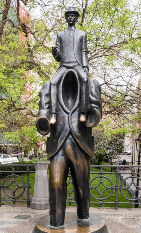 Statue of Franz Kafka, the German-speaking Prague-native Bohemian Jewish novelist and short story writer (known for exploring themes of alienation, existential anxiety, guilt and absurdi