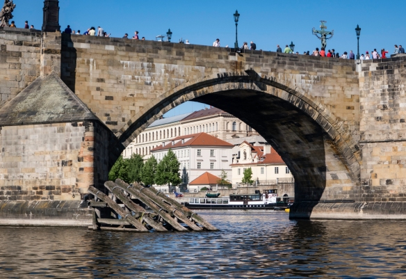 The barricade in front of the bridge is for its protection– viewed from the Vltava River, Prague, Czech Republic
