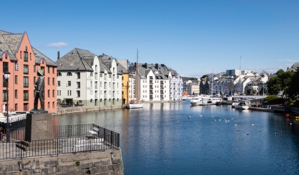 The Brosundet channel separates the two main islands of Ålesund, Norway; the white and pastel buildings are all in the Art Nouveau architectural style in which most of the town was reb