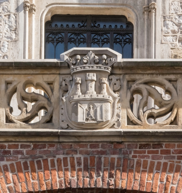 The coat of arms of Kraków, Poland, carved above the entrance to the city at the Florińska Gate
