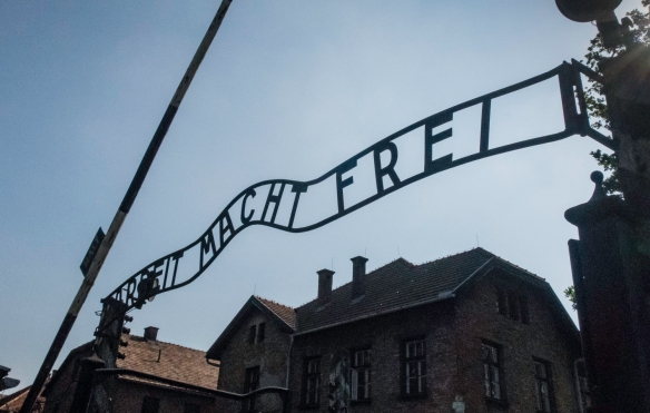 """The entrance to Auschwitz, Oświęcim, Poland, is marked by the infamous sign """"Arbeit Macht Frei"""" ('Work Makes You Free'); note that the one photographed is a replica, as the origi"""