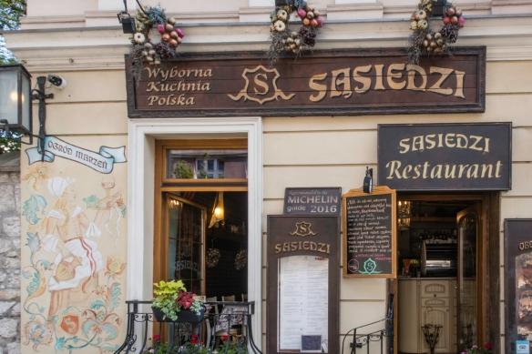 The entrance to Restauracja Sasiedzi, Kazimierz, Kraków, Poland, established in 2010 with chefs specializing in Polish cuisine and a very helpful staff