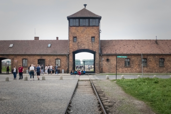The main railroad spur line led directly into and through the administration building (housing the Nazi SS officers and guard) at Birkenau (Auschwitz II) concentration-death camp in Oś