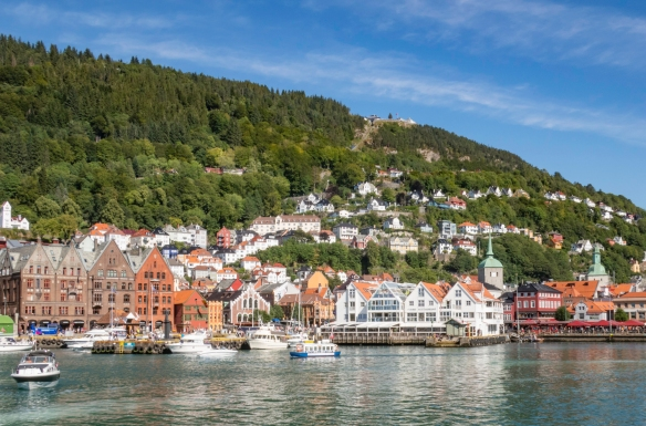 The northeastern side of the inner harbor (Vågen Harbor) of Bergen, Norway, with the tram stop and restaurant atop Mount Fløyen visible in the center top of the photograph